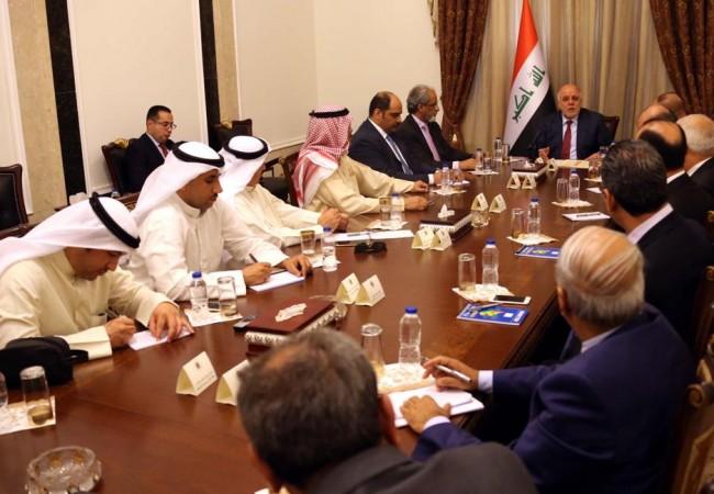العبادي لوفد صحفي كويتي: العلاقات العراقية الكويتية انتقلت من التأزيم الى الانسجام