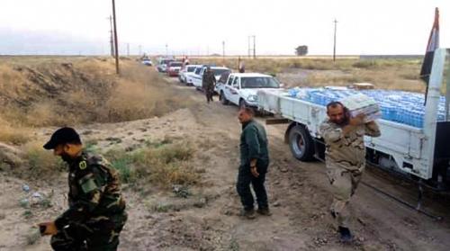 العتبة الحسينية تسير قافلة مؤن غذائية الى القوات الامنية والحشد الشعبي غرب كربلاء المقدسة